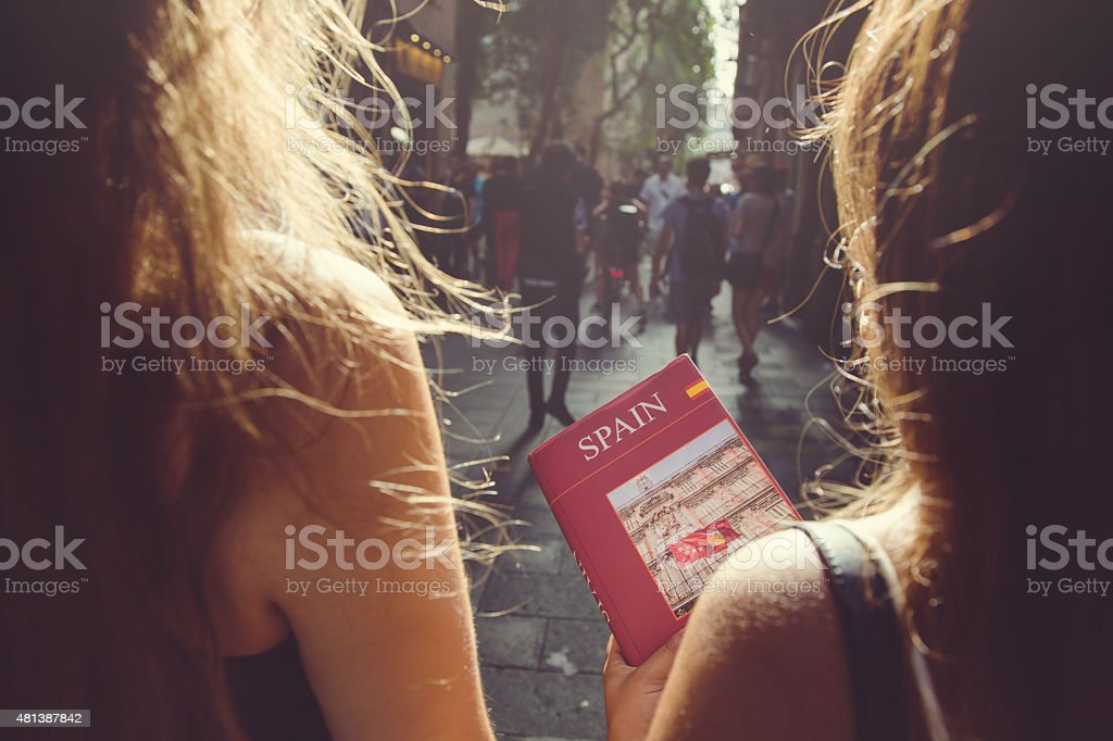 Tourists in Barcelona with guide book stock photo