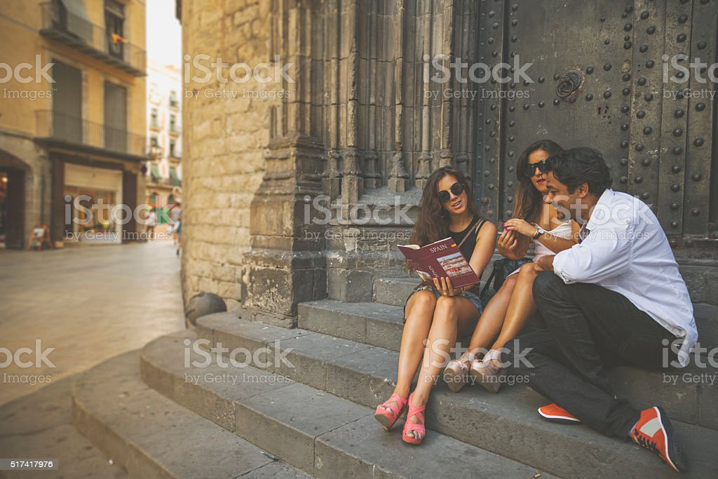 Tourists in Barri gothic, Barcelona, with guide book stock photo