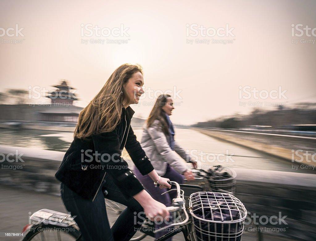 Tourists in Beijing riding bikes stock photo