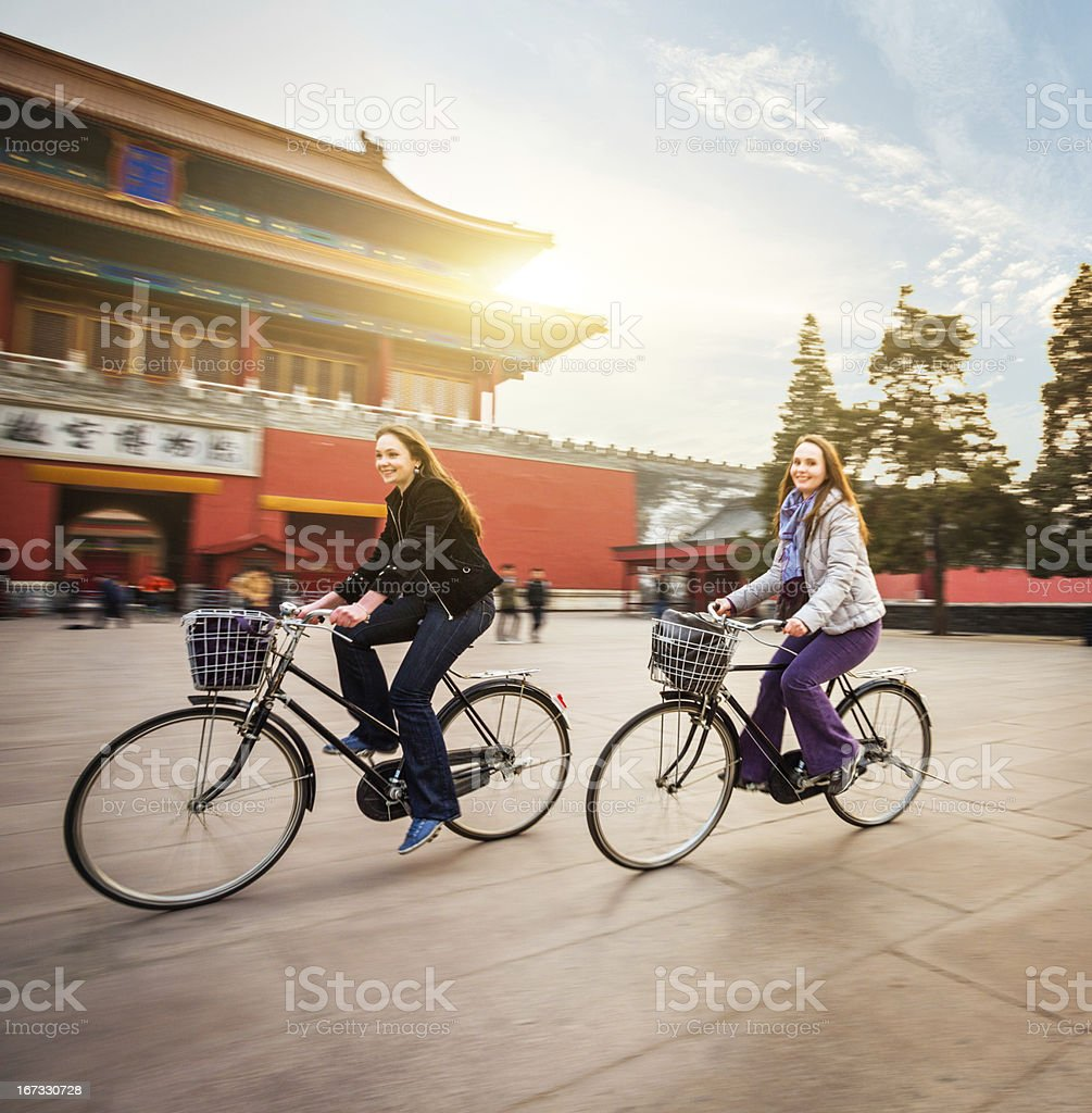Tourists in Beijing riding bikes stock photo