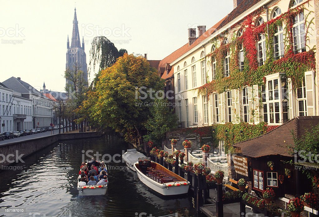Tourists in boat, Bruges,Belgium stock photo