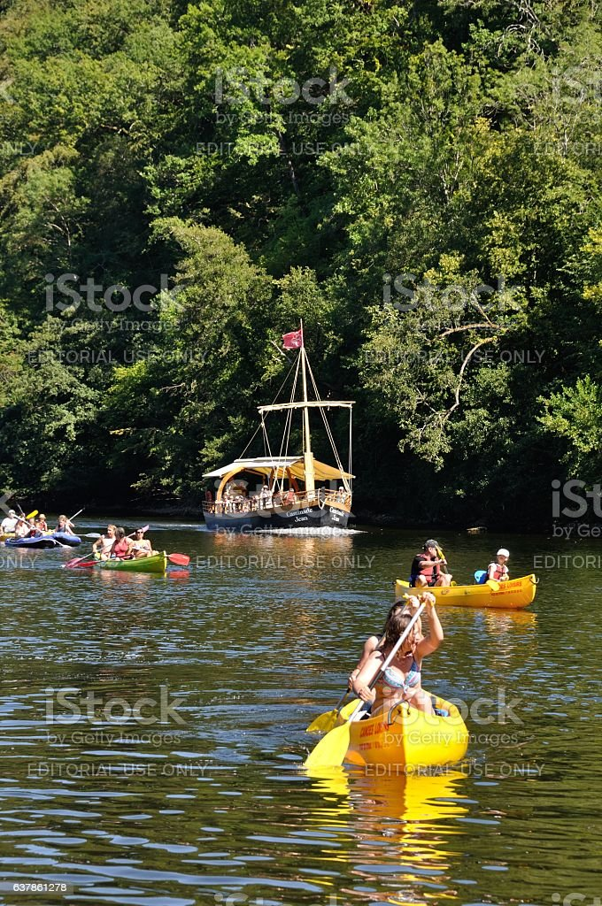 Tourists in canoe and gabare stock photo