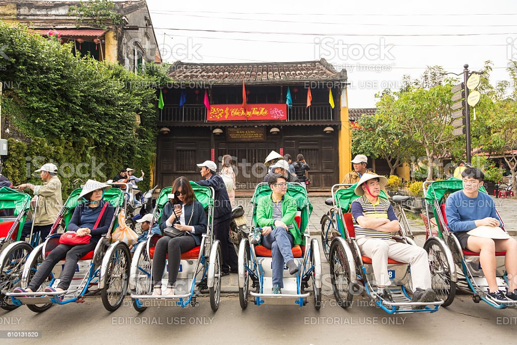Tourists in cyclo in Hoi An in Vietnam stock photo