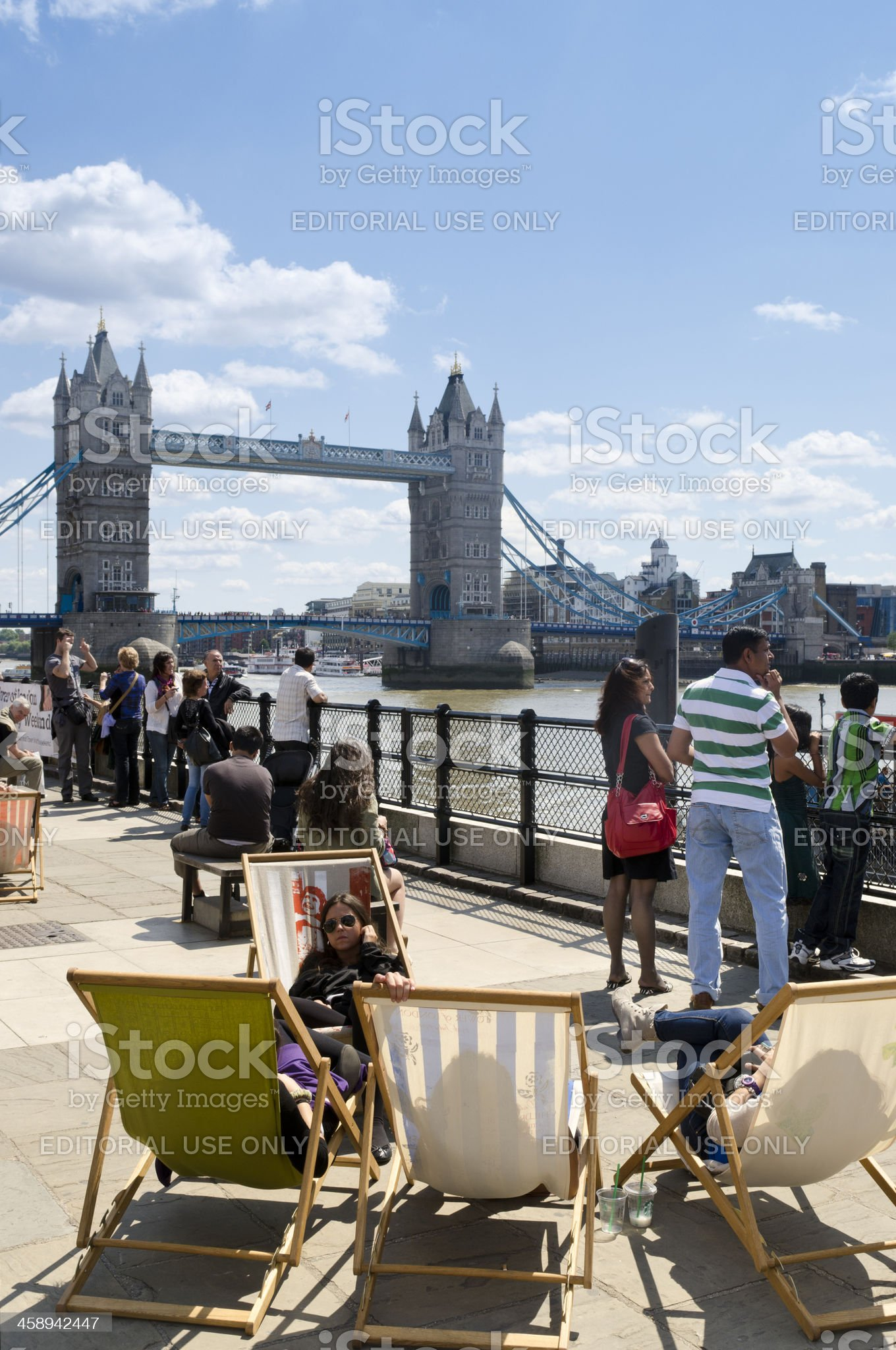 Tourists in deckchairs, Tower Bridge, London royalty-free stock photo