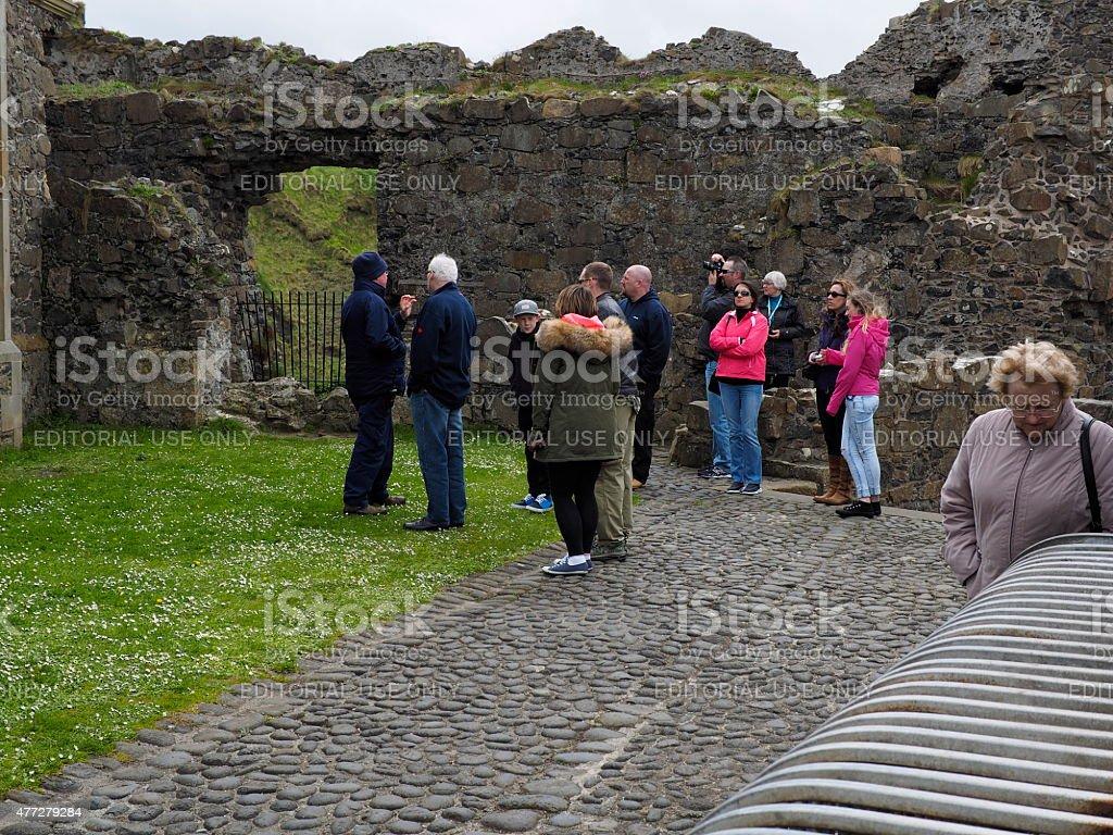 tourists in dunluce castle stock photo