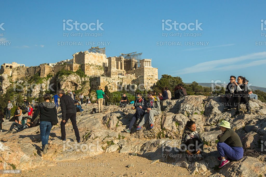 Tourists in famous old city Acropolis. stock photo