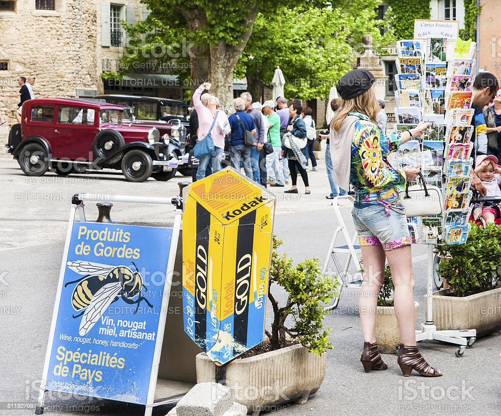 Tourists in French village. stock photo