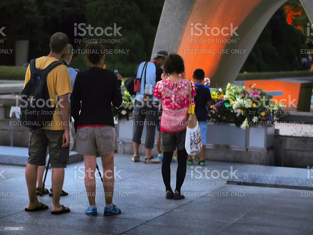 Tourists in front of eternal fire in Hiroshima stock photo