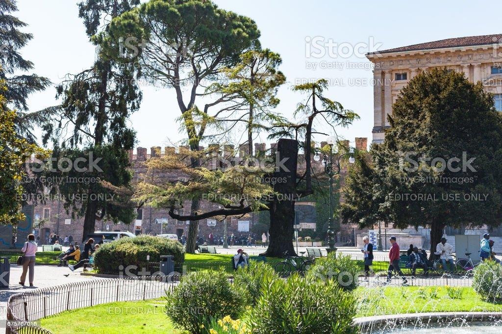 tourists in garden on Piazza Bra in Verona stock photo