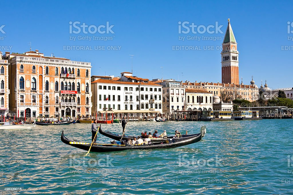Tourists in gondols at Grand Canal in Italy stock photo