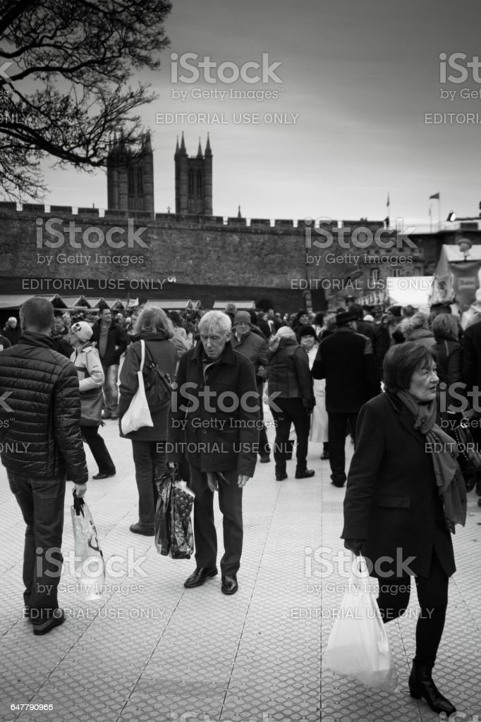 Tourists in Lincoln on the way to the Christmas market. stock photo
