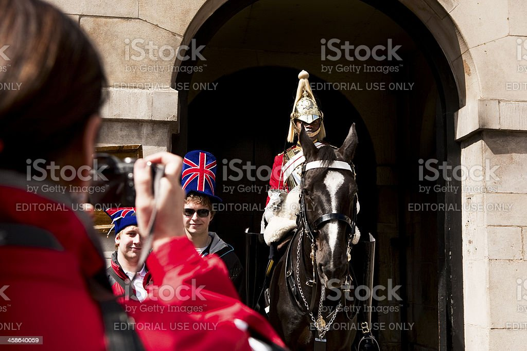tourists in london England at horseguards photographing sentry stock photo