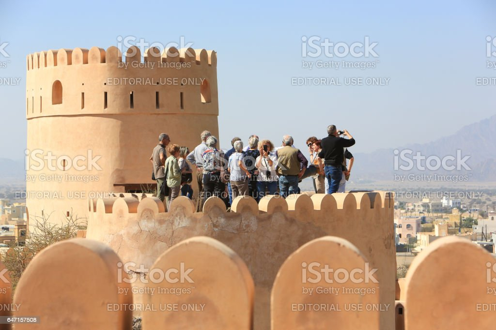 Tourists in Nakhal Fort, Oman stock photo