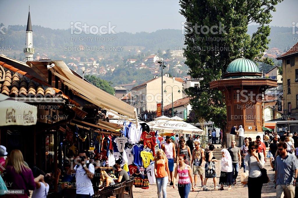 Tourists in old Sarajevo bazaar stock photo