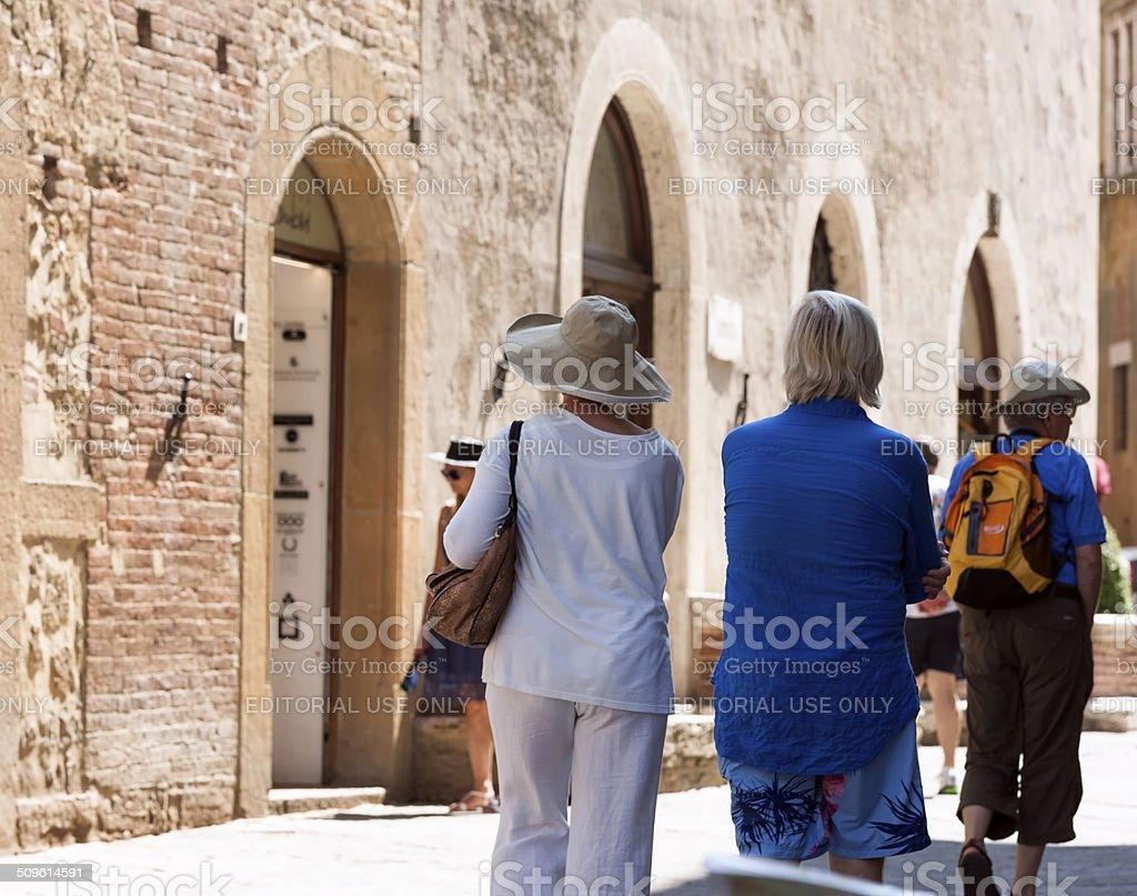 Tourists in Pienza stock photo