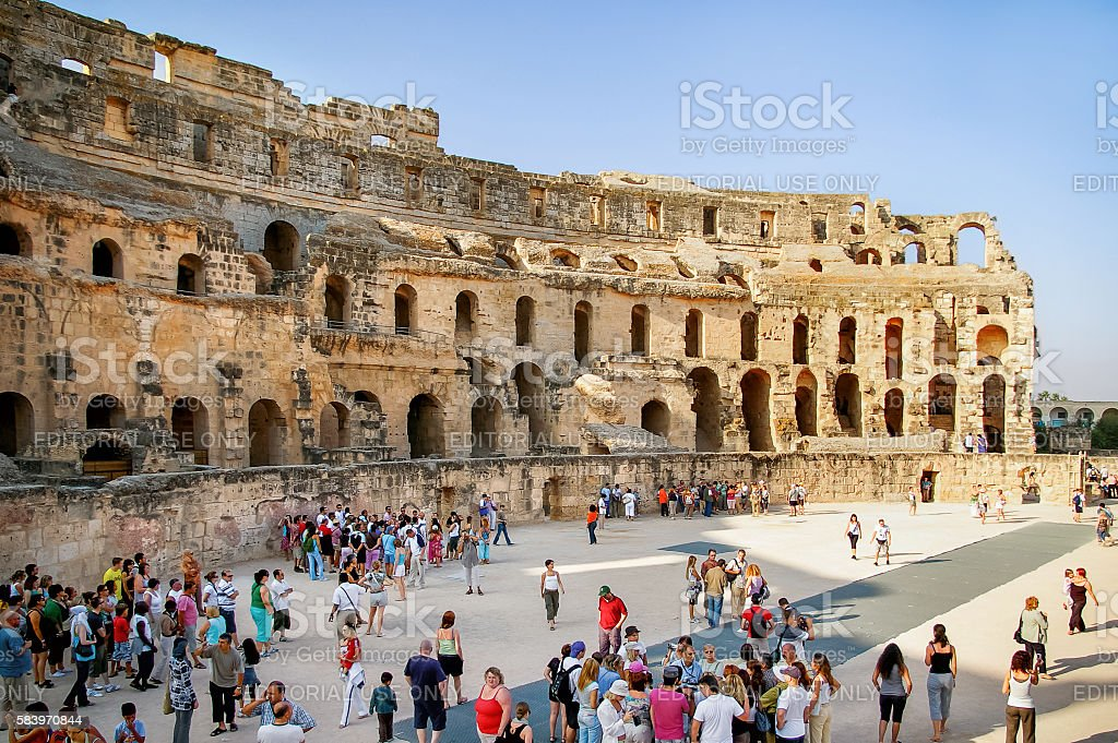 Tourists in ruins of El Djem amphitheatre. stock photo