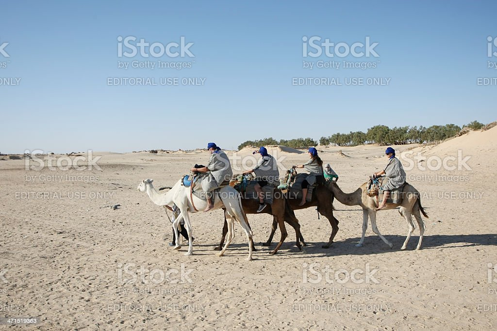 Tourists in Sahara royalty-free stock photo