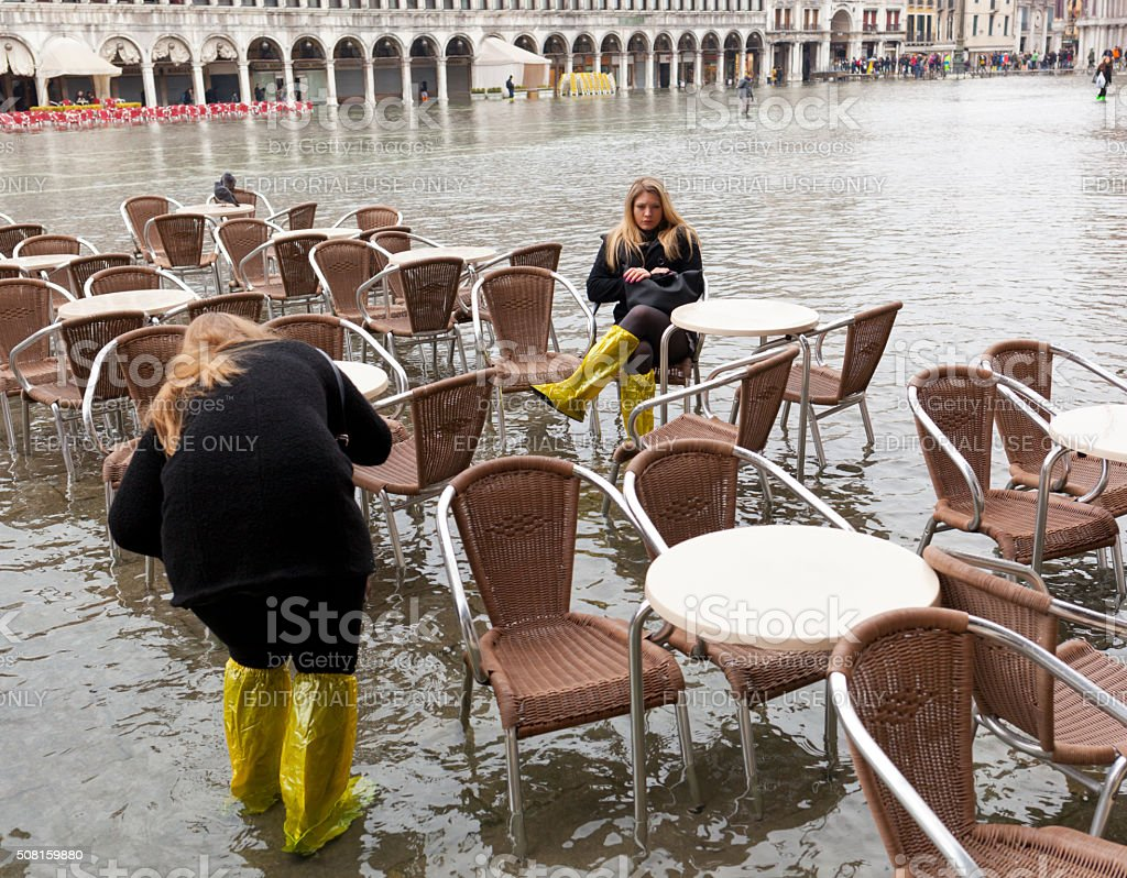 Tourists in San Marco square with high tide, Venice, Italy. stock photo
