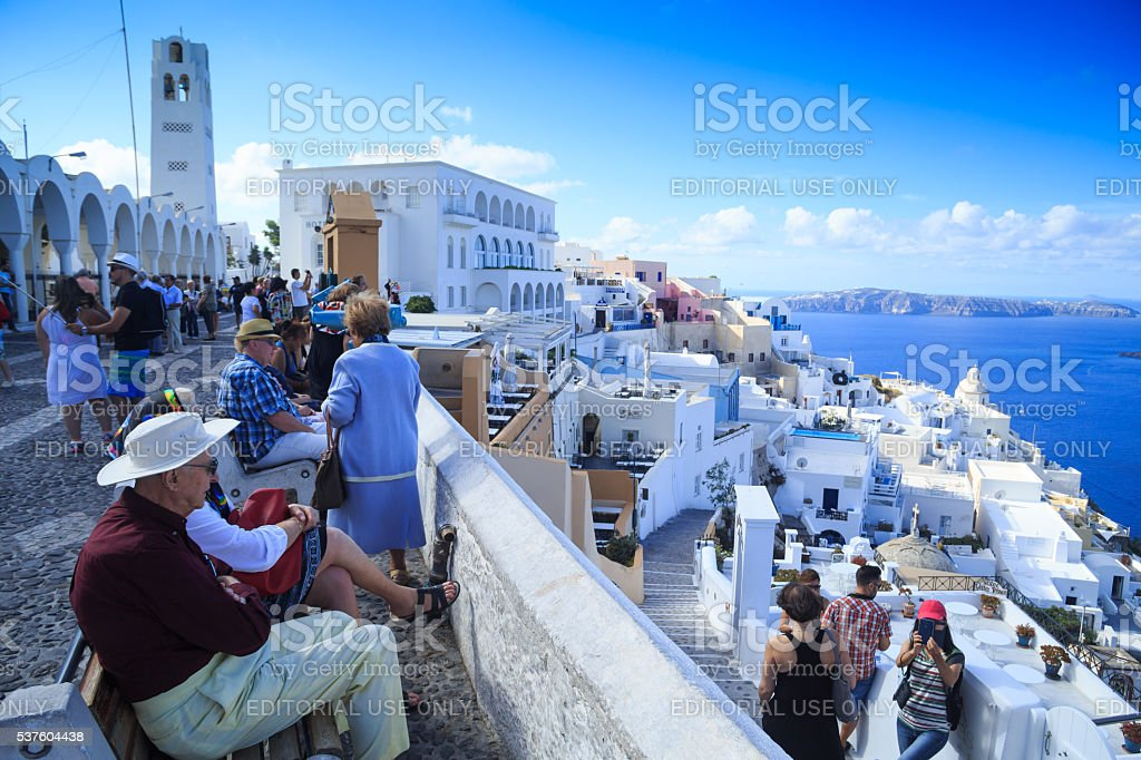 Tourists in Santorini, Greece stock photo