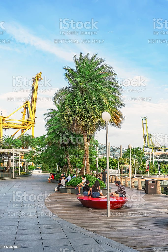 Tourists in Sentosa Boardwalk leading from Singapore Mainland stock photo