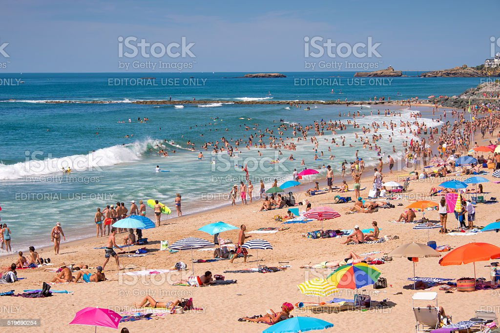 Tourists in summer on Milady beach, in Biarritz, France stock photo