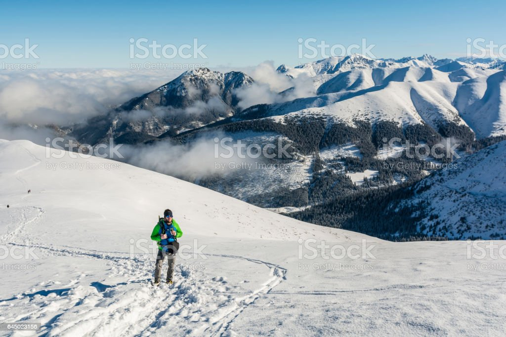 Tourists in sunglasses on a snowy slope. stock photo