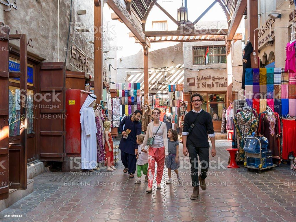 Tourists in textile souk in Bur Dubai stock photo