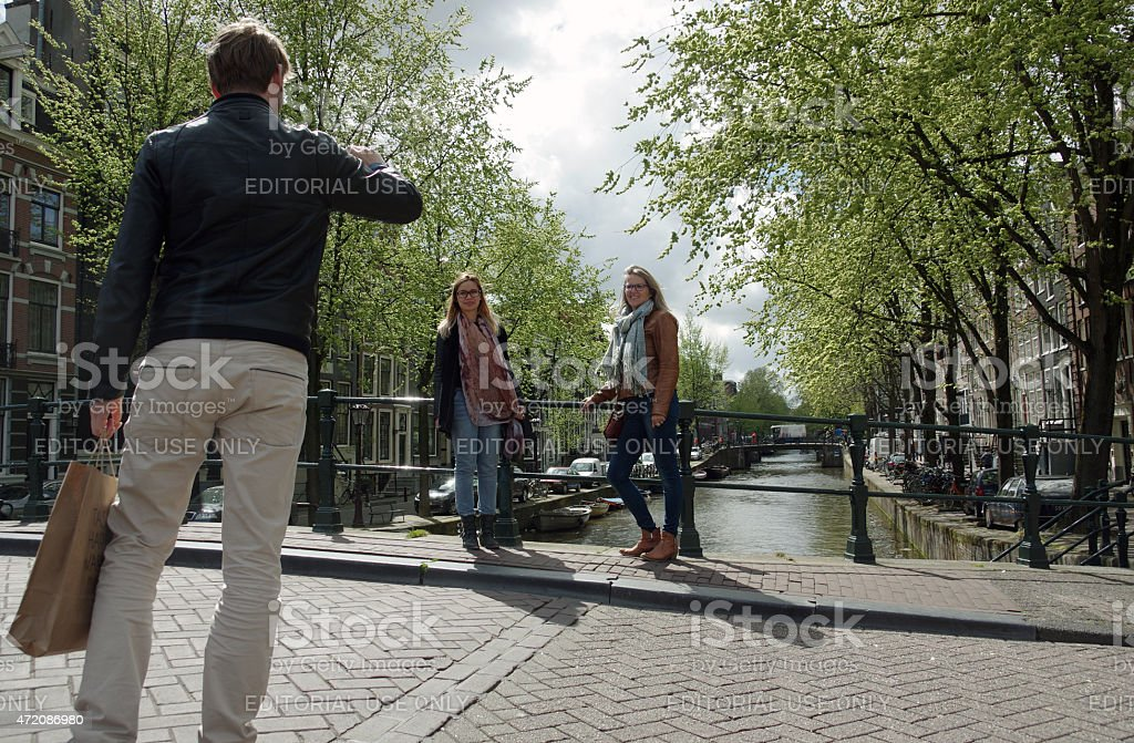 Tourists in the city of Amsterdam stock photo