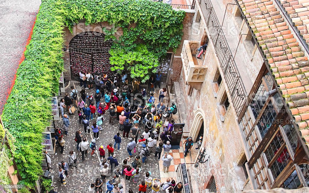 Tourists in the courtyard of Juliet's house. Verona, Italy stock photo