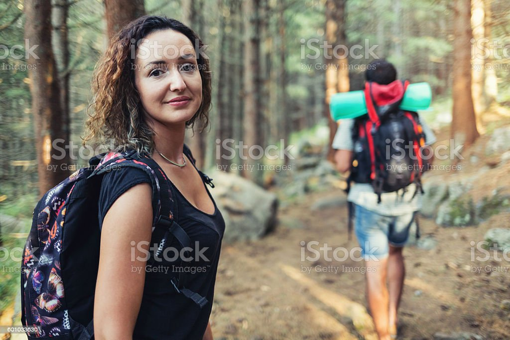 Tourists in the forest stock photo