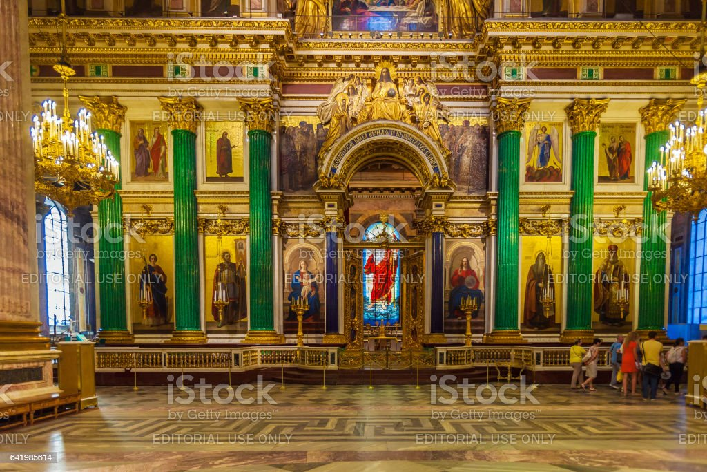 SAINT PETERSBURG, RUSSIA - JULY 26, 2014:  Tourists in the interior of St. Isaac's Cathedral looking at the model of church stock photo