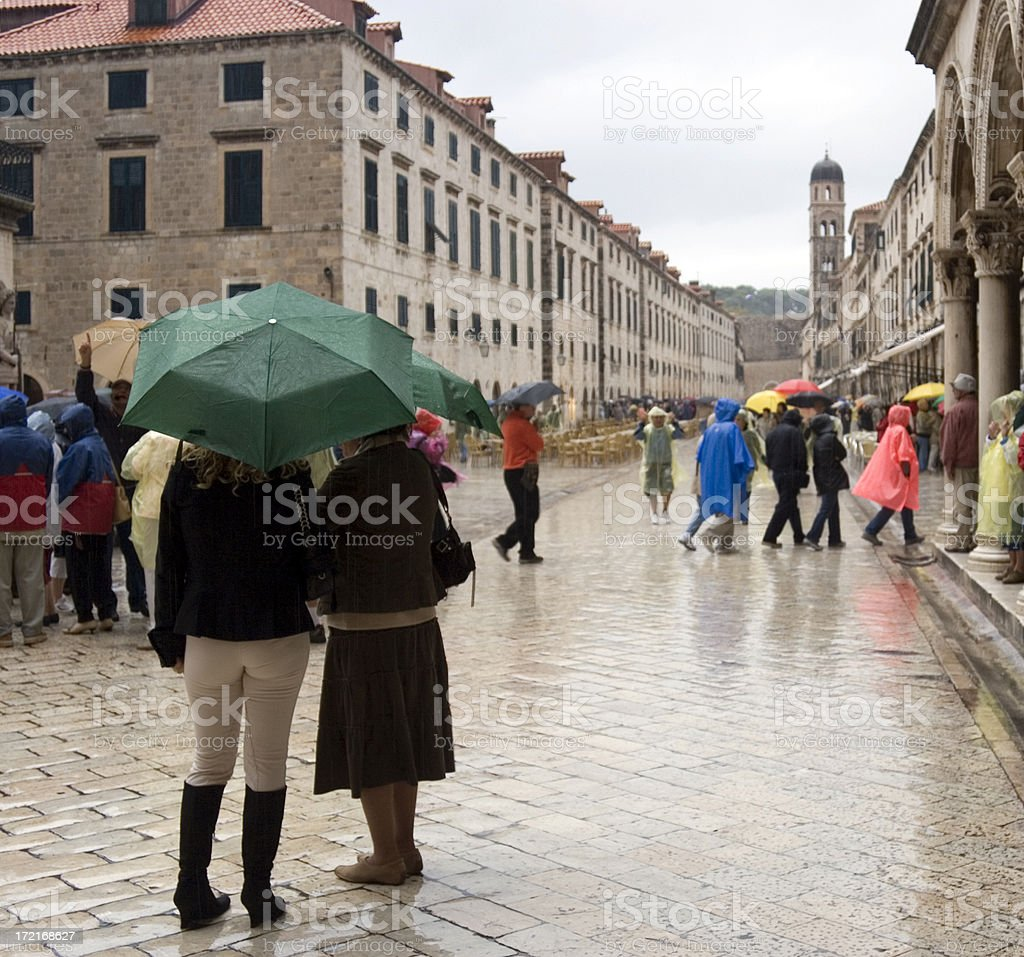 Tourists in the rain royalty-free stock photo