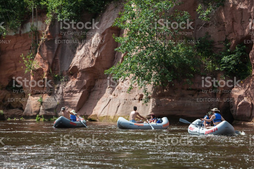 Tourists in the river Gauja stock photo