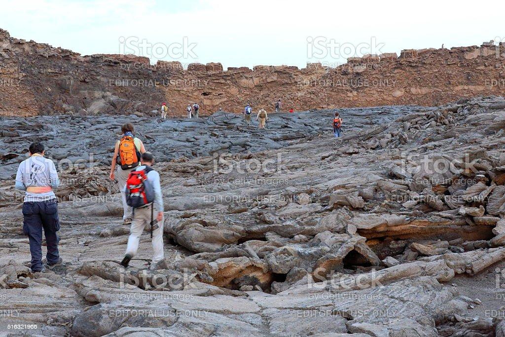 Tourists in the solid lava field-caldera-Erta Ale volcano. Danakil-Ethiopia. 0244 stock photo