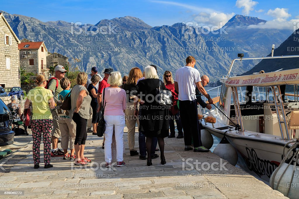 Tourists in the village Perast stock photo