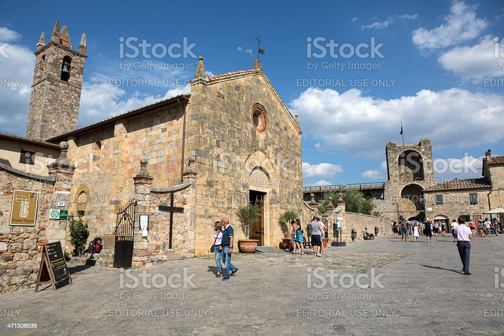 Tourists in town square of Monteriggioni, Italy royalty-free stock photo