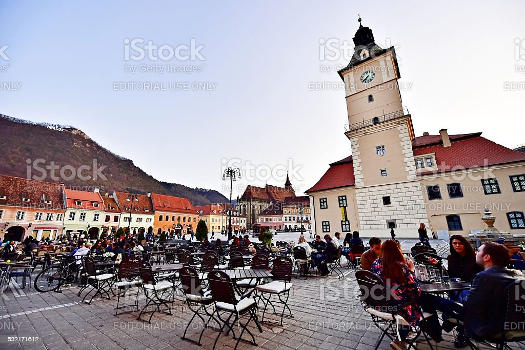 Tourists in Transylvania's medieval old town of Brasov stock photo