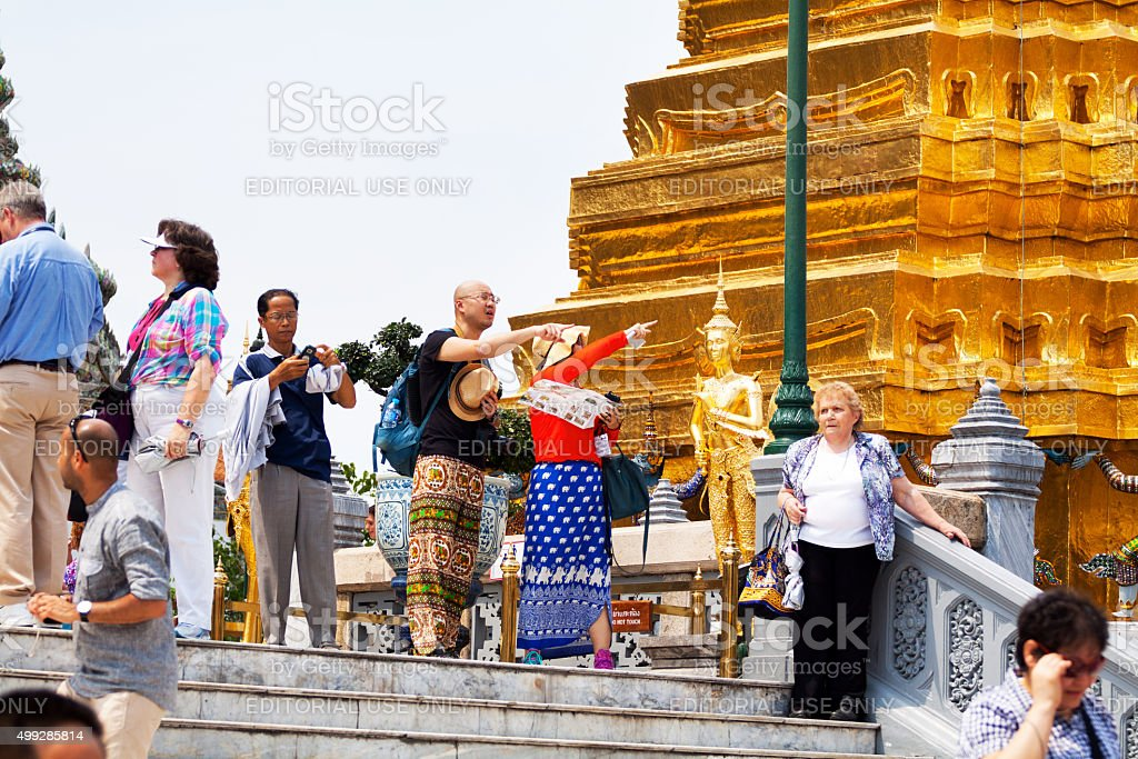 Tourists in Wat Phra Kaeo stock photo