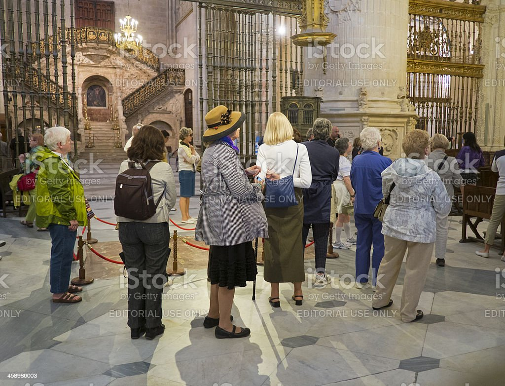 Tourists inside a cathedral stock photo