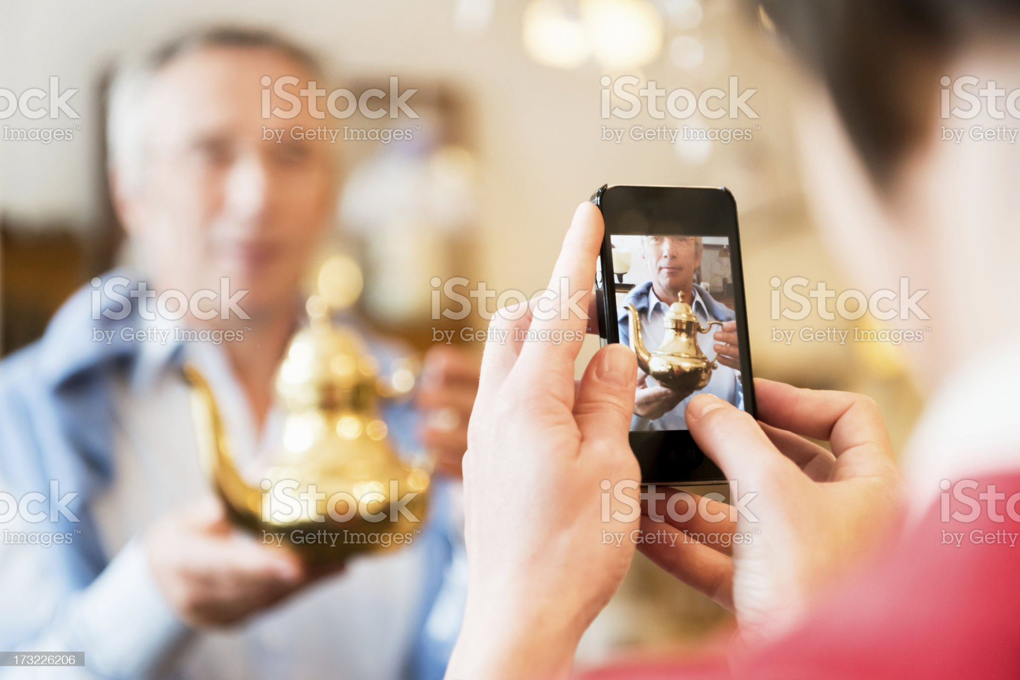 Tourists Inside Antique Store Taking Pictures royalty-free stock photo