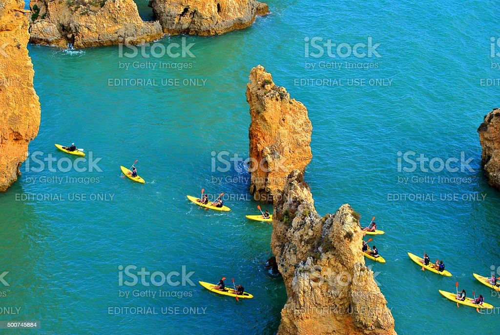 Tourists kayaking through the spectacular rock formations stock photo