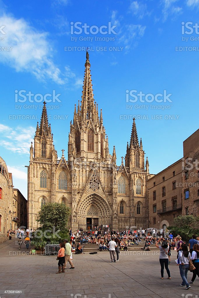 Tourists look at Barcelona cathedral facade royalty-free stock photo