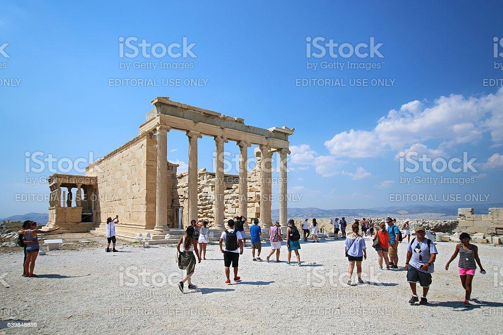 Tourists look at Erechtheion in Athens Acropolis, Greece stock photo