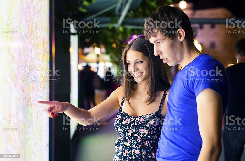 Tourists looking at city map royalty-free stock photo