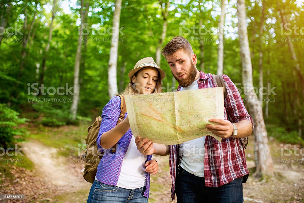 Tourists looking at map stock photo