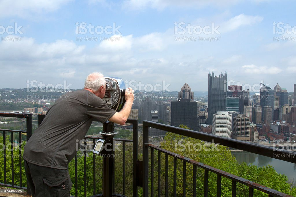 Tourists looking at skyline stock photo