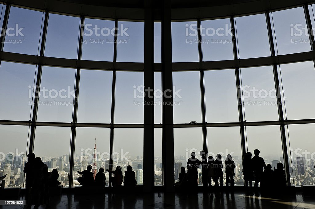 Tourists looking over Tokyo Tower downtown city skyscrapers landmarks Japan royalty-free stock photo