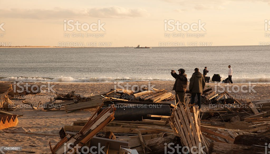 Tourists make a photos of Sandy hurricane consequences royalty-free stock photo