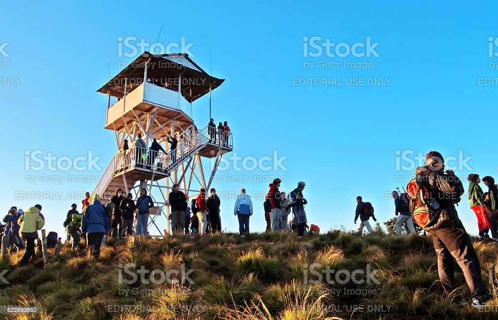 Tourists meet the sunrise at top of Poon Hill, Nepal stock photo