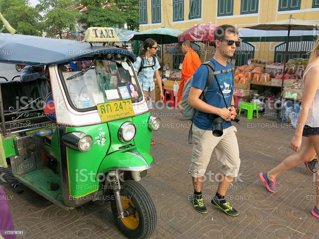 tourists, monk and vendors royalty-free stock photo